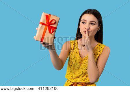 Hush Its Surprise. Cute Pretty Girl Prepare Gift Box. Ask Dont Tell, Put Finger To Lips, Wear Illumi