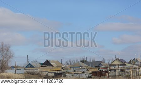 Village In Early Spring. Beautiful Sky And Houses On Outskirts. Wide Format, Panoramic Rural Landsca