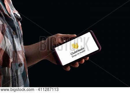 Moscow, Russia - February 10, 2021: A Hand Holds A Smartphone With The Club House App On The Screen.