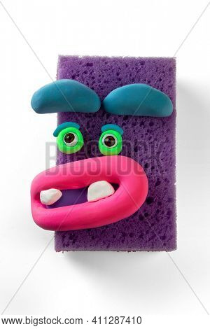 Animated sponge with eyes and lips by soft modeling clay. Emotions things