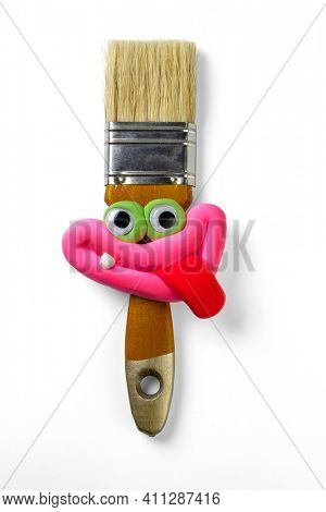 Animated tassel with eyes and lips and tongue isolated on the white background. Cartoon plasticine parts of face on thing