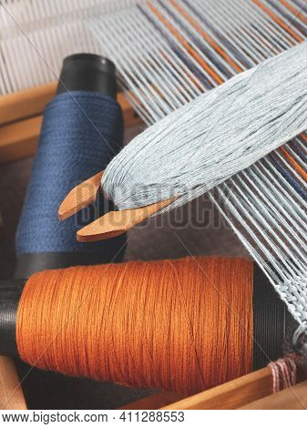 Shuttle With Blue Thread And Two Bobbins With Indigo And Orange Yarns For Weaving Striped Textile, U