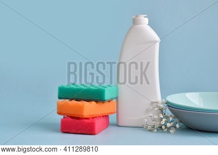 Dish Detergent. Cleaning The Kitchen. Cleaning Products On A Blue Background. Cleaning In The House,