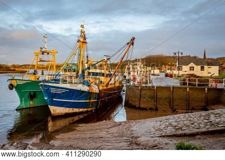 Fishing Trawlers Moored At Kirkcudbright Harbour On The River Dee At Sunset In Winter, Dumfries And