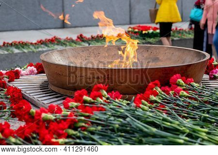 Eternal Fire And Flowers In Memory Of Victims In The World War On Victory Day On 9 May.burning Etern