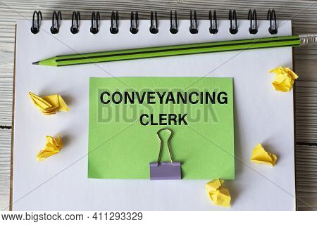 Conveyancing Clerk - Words On A Green Sheet On A White Notebook With A Pencil And Small Pieces Of Pa
