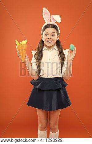 Easter Dinner. Easter Carrot Recipes. Stay Healthy And Happy. Small Girl Hold Carrot And Eggs. Egg H