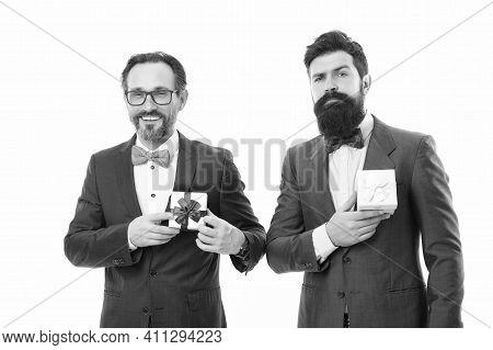Success And Reward. Esthete. Businessmen In Formal Suit On Party. Bearded Men Hold Valentines Presen