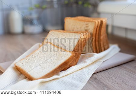 Sliced Toast Bread On The Table In The Kitchen, Slices Of White Bread, Close Up.