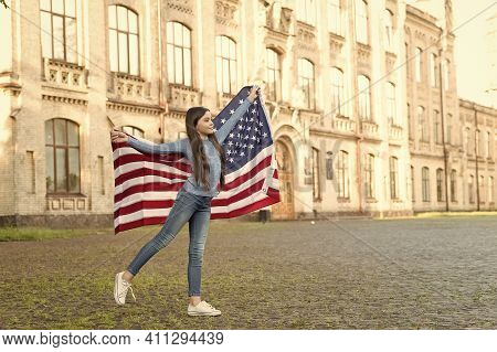Being Proud American. Little Child Hold American Flag. Celebrating Independence Day. July 4th. Ameri