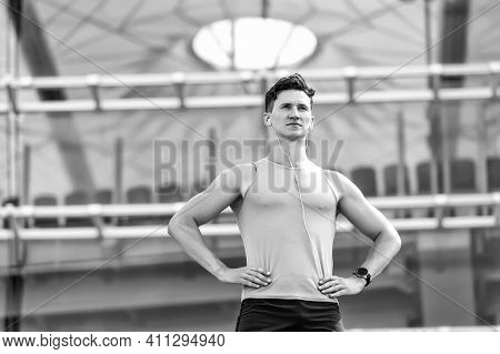 Mind And Body In Harmony. Stylish Guy In The Gym Posing For A Photo. Athlete On Way To Stronger Body