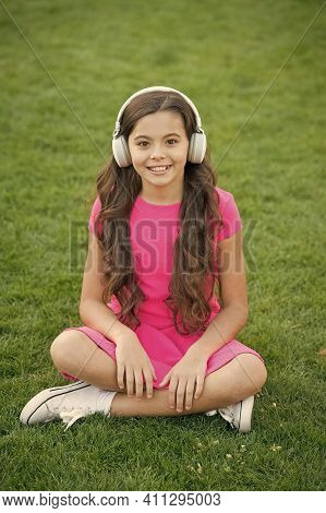 Educational Podcast. Kid Girl Enjoy Music Green Grass Meadow. Pleasant Time. Child Headphones Listen