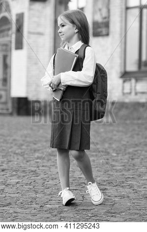 Small Kid In Formal Uniform With Back To School Look Carry Bag Holding Books And Supplies, College.