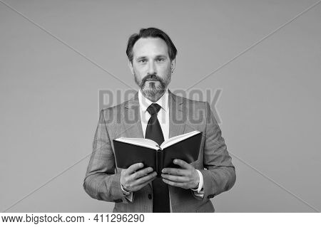 Mature Man Reading Business Literature. Bearded Man In Suit Read Book. Accountant Maintains Accounti