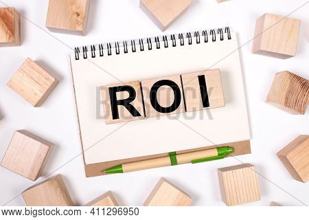 Return On Investment .roi. Text On Wood Cubes. Text In Black Letters On Wood Blocks