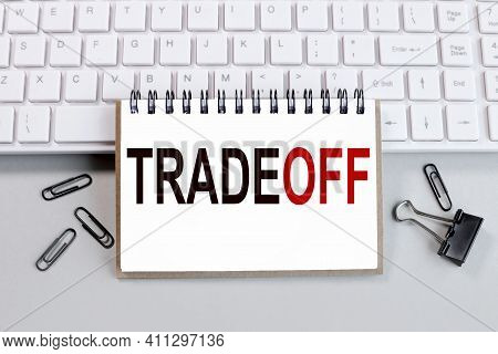Trade-off. Text On White Notepad Paper On White Keyboard