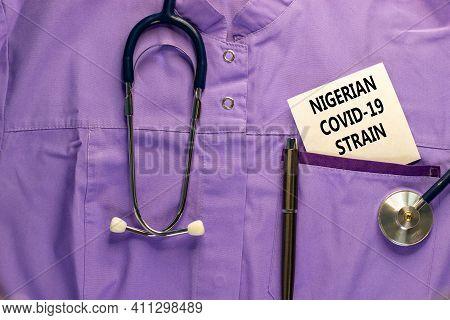 Covid-19 Nigerian Strain Symbol. Medical Uniform, White Card With Words 'nigerian Covid-19 Strain',