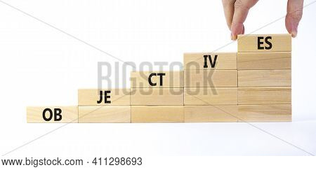 Objectives Symbol. Wooden Blocks Stacking As Step Stair On White Background, Copy Space. Businessman