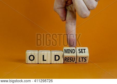 Old Mindset And Results Symbol. Businessman Turns Wooden Cubes And Changes Words 'old Mindset' To 'o