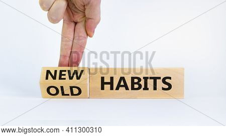 New Habits Symbol. Businessman Turns A Wooden Block And Changes Words 'old Habits' To 'new Habits'.
