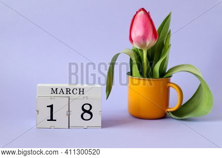 Calendar For March 18: Cubes With The Number 18, The Name Of The Month March In English, A Scarlet T