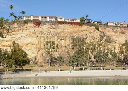 DANA POINT, CA - NOVEMBER 4, 2016: Dana Point Harbor Beach with homes on the bluffs above.