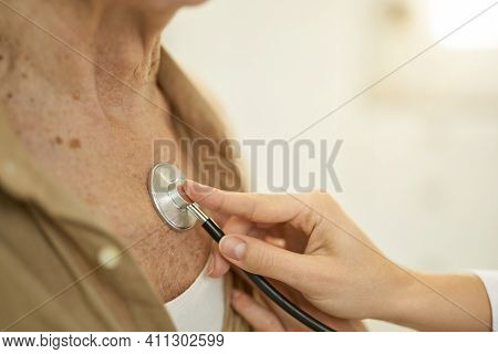 Healthcare Professional Checking Heart And Lungs Of Man With Stethoscope
