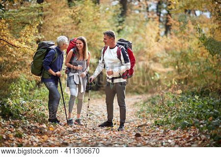 Hikers at pause of hiking in nature