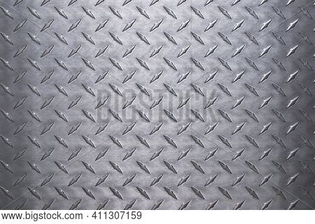 Light Aluminum Plate Background, Silver Metal With A Diamond Texture.