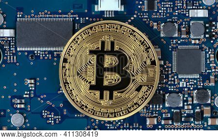 Single Bit Coin With Computer Circuit Board In Background For Future Currency Concept
