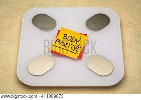 body positive - reminder note on a bathroom scale, self acceptance and positive mindset concept
