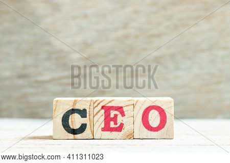 Alphabet Letter Block In Word Ceo (abbreviation Of Chief Executive Officer) On Wood Background