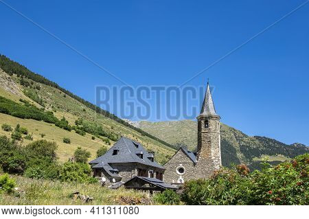 Exterior View Of The Montgarri High Mountain Refuge In Summer, With The Pyrenees Mountains Of The Ar