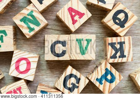 Alphabet Letter Block In Word Cv (abbreviation Of Curriculum Vitae) With Another On Wood Background