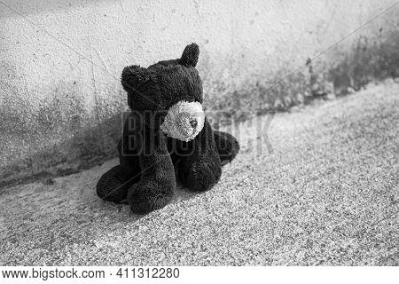ฺbroken Heart, Neglect, Lonely With Alone Teddy Bear Sitting Sad Face On Dirty Cement Floor. Black A