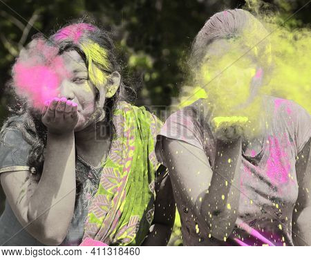 Two Girls Celebrate Holi Festival. The Indian Hindu Festival Is Also Known As Festival Of Colors And