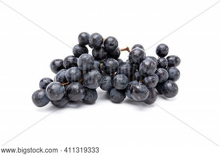 Bunch Of Organic Black Grapes Isolated On White Background