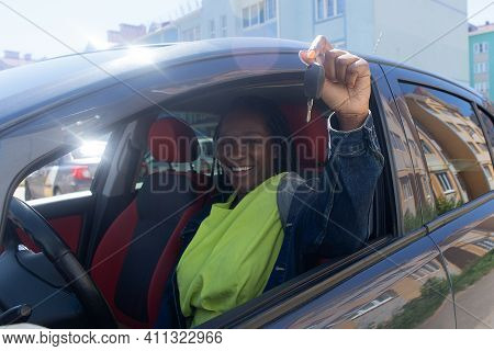 The Happy African American Shows Key To Car