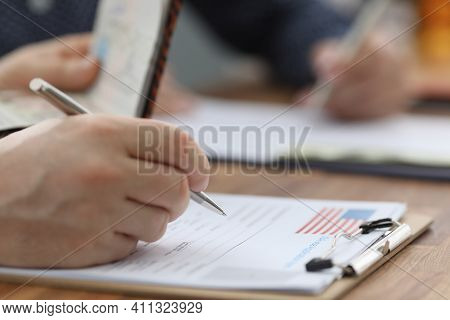 Man Filling Out Documents For Us Visa Closeup. Official Travel Abroad Concept