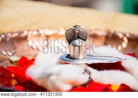 Stock Photo Of A Silver Shivlinga Which Is Icon Of Lord Shiva Snake Above Shivlinga, Being Worshiped