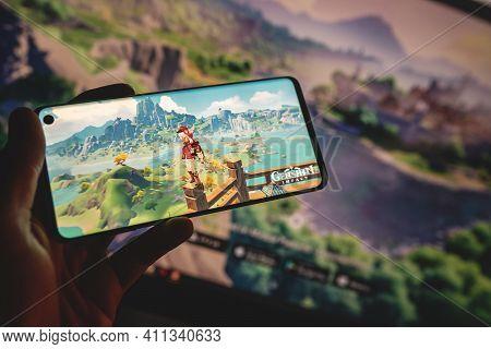 Swansea, Uk - March 4, 2021: Genshin Impact Mobile Game On Smartphone, Popular App. Gameplay, Charac