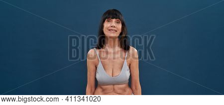 Feeling Young At Any Age. Beautiful Middle Aged Caucasian Woman With Age Wrinkles Around Eyes Posing
