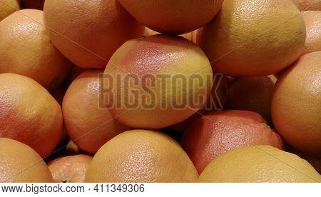 Food Background. A Set Of Fresh Grapefruit On Vegetable Market. Grapefruit Harvest. Many Grapefruit.