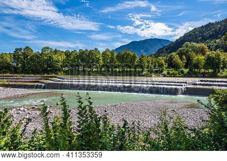 River Saalach With Trees In Bad Reichenhall, Germany.
