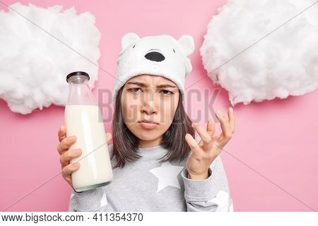 Displeased Sulking Brunette Young Asian Woman Looks Angrily At Camera Has Bad Mood In Morning Dresse