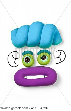 Animated face by soft clay isolated on the white background. Cartoon plasticine face with drawn elements