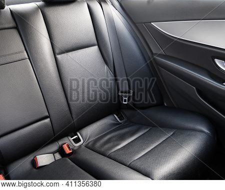 Back Passenger Black Leather Seats In Modern Luxury Car. Black Perforated Leather With Stitching. Ca