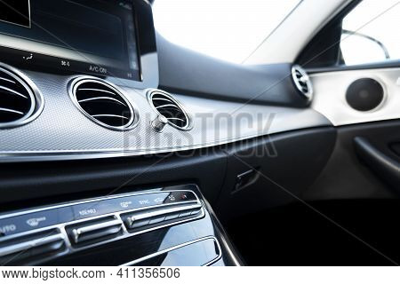 Black Luxury Modern Car Interior. Steering Wheel, Shift Lever And Dashboard. Detail Of Modern Car In