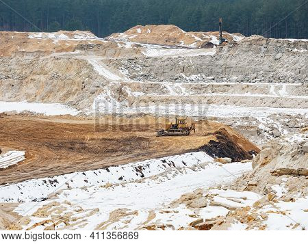 Excavators On Quarrying Site Working On Slica Glass Sand. General Open Mine Pit Scene. Digging A Pit