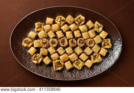 An assorted ottoman sweet - Baklava. Baklawa is a layered pastry dessert made of filo pastry, filled with chopped nuts, and sweetened with syrup or honey.